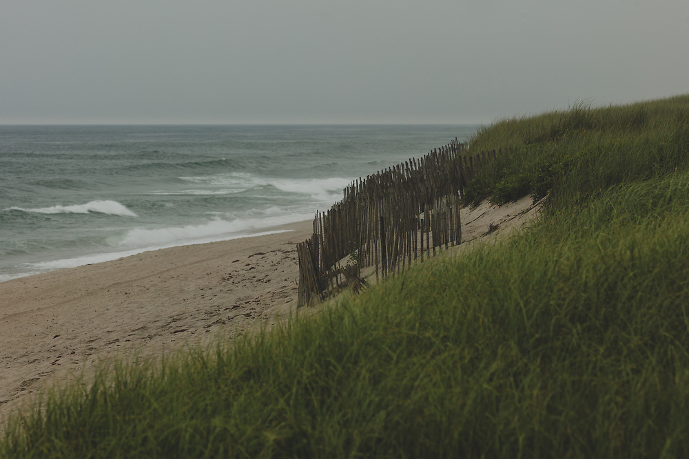 The weathered sand dunes leading to the water at Miacomet.