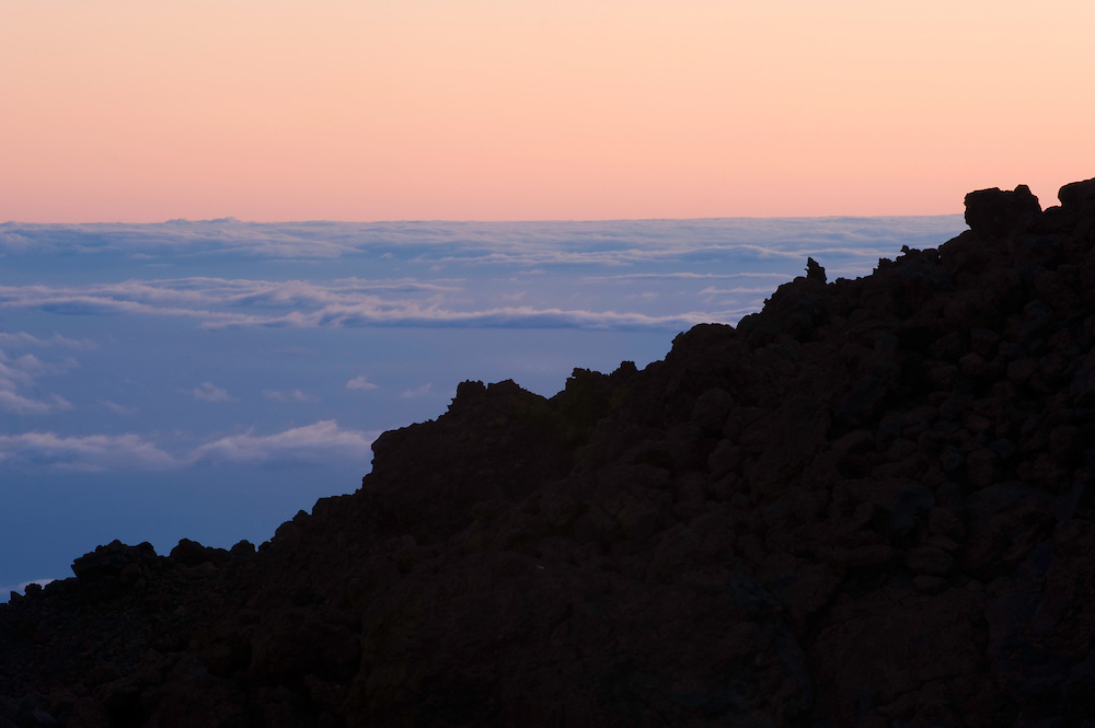 The clouds sea from the Teide at sunset. The Teide volcano is the highest mountain of Spain, 3.718 m. Teide National Park, Tenerife Island, Canary Islands, Spain.