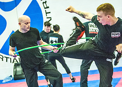 Alan kicks toward the hoop, Stef Noij, KMG Instructor from the Institute Krav Maga Netherlands, at the IKMS G Level Programme seminar today at the Scottish Martial Arts Centre, Alloa.