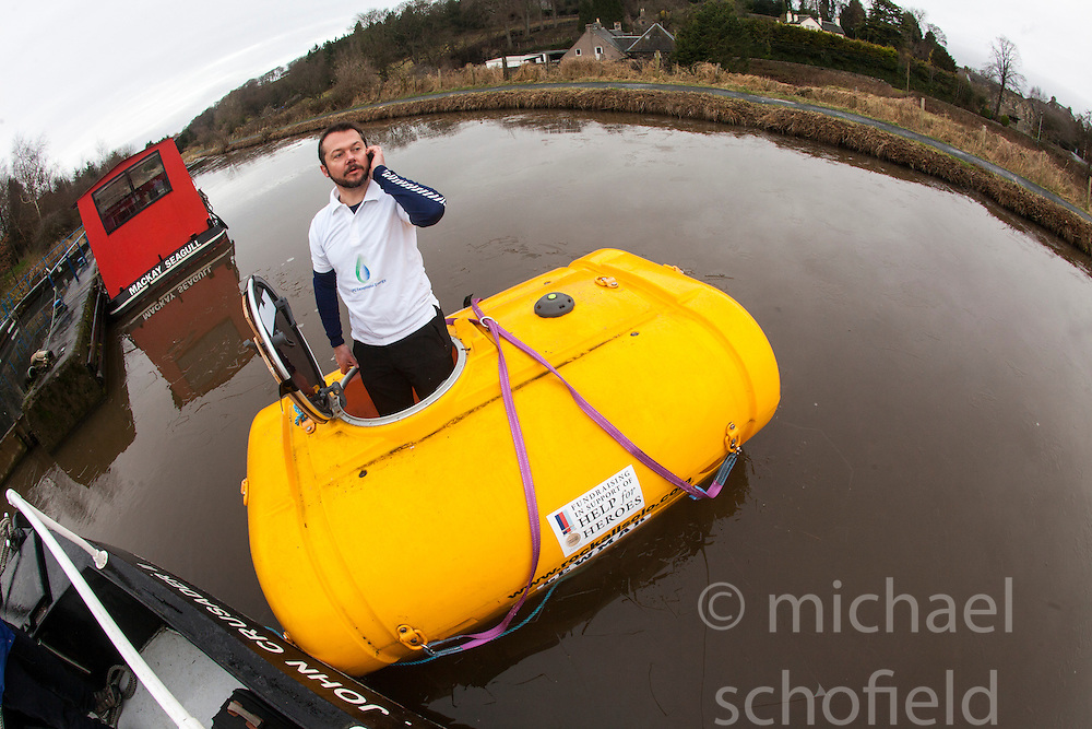 Nick Hancock floats his RockPod on the Union Canal at the Seagull Trust canal dock, Ratho. Nick Hancock's Rockall Solo Endurance Expedition in aid of Help for Heroes, plans to land on Rockall and survive solo for 60 days thereby setting a record for the longest occupation of Rockall, and is intended for Spring/Summer 2013.