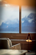 Reading lamp and armchair in lounge of Tierra Patagonia Hotel with mountain view, Torres del Paine National Park, Patagonia, Chile