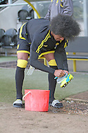 Burton No.34 Hamza Choudhury cleaning his boots before the Sky Bet League 1 match between Burton Albion and Bury at the Pirelli Stadium, Burton upon Trent, England on 2 April 2016. Photo by Nigel Cole.