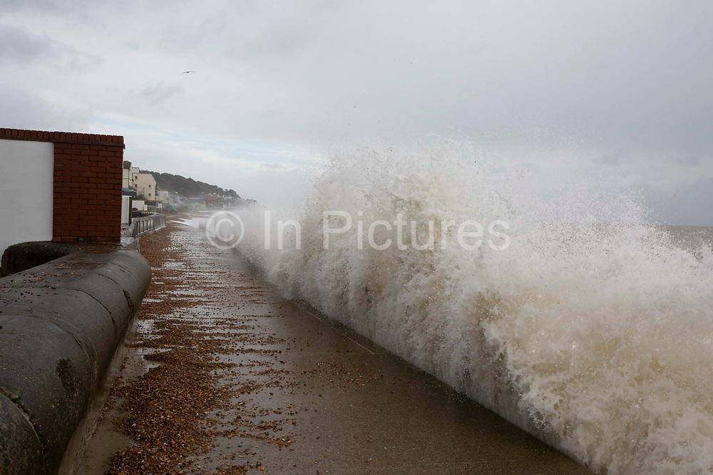 Waves cresting over the pedestrian walkway in Sandgate, Kent on the south coast of England, as Storm Ciara continues to sweep over the country on February 10th 2020 in Folkestone, United Kingdom. Amber weather warnings were put into place by the MET office as gusts of up to 90mph and heavy rain swept across the UK. An amber warning from the MET office expects a powerful storm that will disrupt air, rail and sea links travel, cancel sports events, cut electrical power and damage property.