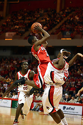 "03 February 2007: Daniel Ruffin leans in on  Keith ""Boo"" Richardson for a shot. In what is locally referred to as the War on Seventy Four, the Bradley Braves defeated the Illinois State University Redbirds 70-62 on Doug Collins Court inside Redbird Arena in Normal Illinois."