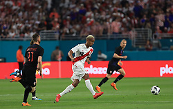 March 23, 2018 - Miami Gardens, Florida, USA - Peru forward Andre Carrillo (18) kicks the ball during a FIFA World Cup 2018 preparation match between the Peru National Soccer Team and the Croatia National Soccer Team at the Hard Rock Stadium in Miami Gardens, Florida. (Credit Image: © Mario Houben via ZUMA Wire)