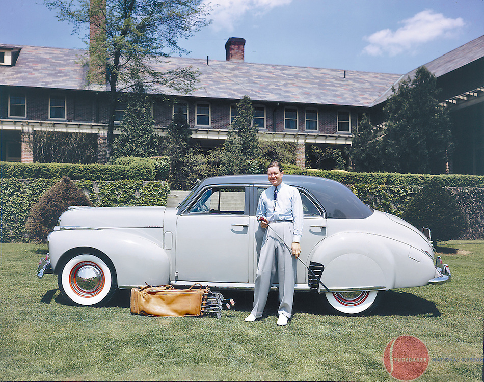 Golfer Byron Nelson poses with a 1941 Studebaker President Skyway Land Cruiser.