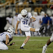 ORLANDO, FL - OCTOBER 03:  Zack Long #90 of the Tulsa Golden Hurricane kicks an extra point against the Central Florida Knights as Cannon Montgomery #20 of the Tulsa Golden Hurricane holds for him at Bright House Networks Stadium on October 3, 2020 in Orlando, Florida. (Photo by Alex Menendez/Getty Images) *** Local Caption *** Zack Long; Cannon Montgomery