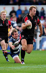 Ulster Ravens' Roger Wilson avoids a challenge from Bristol Rugby's James Grindal - Photo mandatory by-line: Dougie Allward/JMP  - Tel: Mobile:07966 386802 21/10/2012 - SPORT - Rugby Union - British and Irish Cup -  Bristol  - The Memorial Stadium - Bristol Rugby V Ulster Ravens