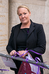 """© Licensed to London News Pictures. 11/03/2019. London, UK. Lacey Rigby, an activist from anti-knife campaign """"Take a Knife, Save a Life"""" ties purple ribbons around the Old Bailey in memory of 17-year-old Jodie Chesney who was stabbed to death in a playground in Harold Hill, Romford, on 1 March. Today, Manuel Petrovic appears in court charged with the murder of Jodie Chesney. Photo credit : Tom Nicholson/LNP"""