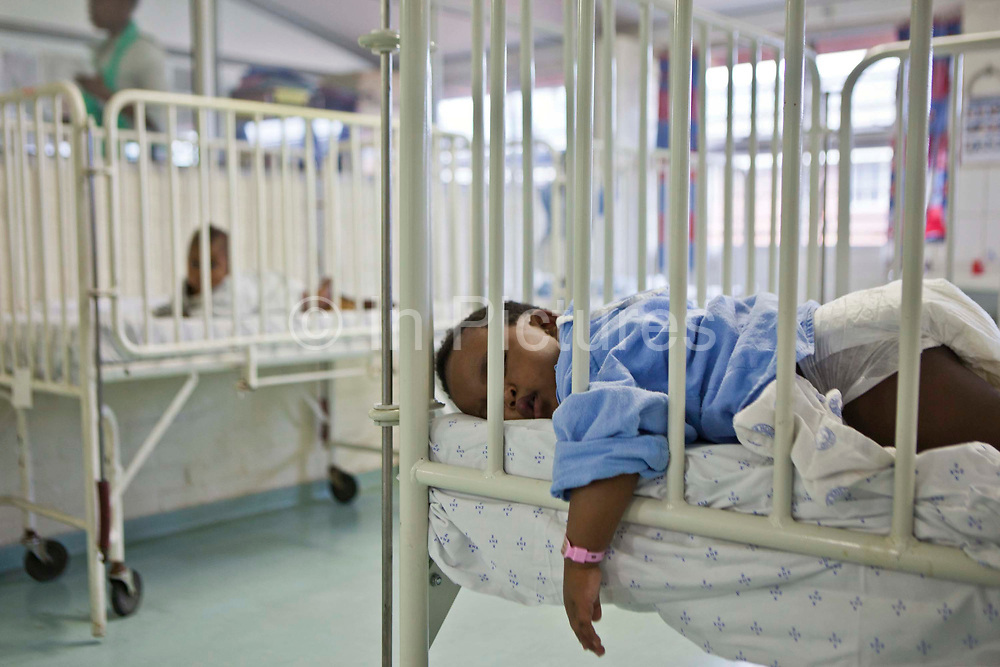 An African baby sleeping in their cot on the pediatric ward at Clairwood Hospital, Durban, South Africa.  Bigshoes Foundation provide palliative and hospice care at this hospital.