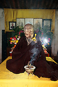 QUANZHOU, CHINA - JANUARY 10: (CHINA OUT) <br /> <br /> monk Fuhous body which was found not rotted after putting in a vat for three and a half years at Puzhao temple on Zimao Mountain on January 10, 2016 in Quanzhou, Fujian Province of China. 94-year-old monk Fuhou died in 2012 and his body was put by the sitting position into a vat with a cover for three and a half years. Monks found that Fuhous body wasn\'t rotted on an opening vat rite on January 10 at Puzhao temple on Zimao Mountain in Quanzhou. The body would be cleaned and stuck with gold to be made into a golden Buddha. <br /> ©Exclusivepix Media