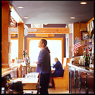 A bartender behind the bar at Bill's Tavern, a microbrewery in the beach town of Cannon Beach, Oregon