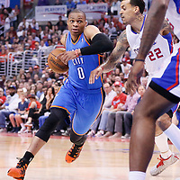 11 May 2014: Oklahoma City Thunder guard Russell Westbrook (0) drives past Los Angeles Clippers forward Matt Barnes (22) during the Los Angeles Clippers 101-99 victory over the Oklahoma City Thunder, during Game Four of the Western Conference Semifinals of the NBA Playoffs, at the Staples Center, Los Angeles, California, USA.