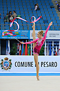 Mateva Mariya during qualifying at ribbon in Pesaro World Cup at Adriatic Arena on 27 April 2013. Mariya was born on June 1,1994 in Burgas. She is a Bulgarian individual rhythmic gymnast.