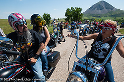 Jack Schit and Melissa Shoemaker on the Cycle Source Ride during the 78th annual Sturgis Motorcycle Rally. Sturgis, SD. USA. Wednesday August 8, 2018. Photography ©2018 Michael Lichter.