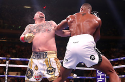 Anthony Joshua (right) lands a punch on Andy Ruiz Jr (right) in the WBA, IBF, WBO and IBO Heavyweight World Championships title fight at Madison Square Garden, New York.