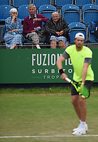 Daniel Brands is watched by 3 older spectators on Day Six of the Fuzion 100 Surbiton Trophy at the Surbiton Racket & Fitness Club, Surrey, United Kingdom.<br /> Picture by Daniel Hambury/Focus Images Ltd 07813022858<br /> 07/06/2018