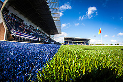 A landscape view of the blue and green colours on the new plastic pitch at The Falkirk Stadium. The Falkirk Stadium, with the new pitch work for the Scottish Championship game v Morton. The woven GreenFields MX synthetic turf and the surface has been specifically designed for football with 50mm tufts compared with the longer 65mm which has been used for mixed football and rugby uses.  It is fully FFA two star compliant and conforms to rules laid out by the SPL and SFL.<br /> ©Michael Schofield.