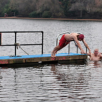 LONDON, ENGLAND - DECEMBER 25:  Members of the Serpentine Swimming Club get ready to  swim in the icy Serpentine waters during the annual Christmas Day Peter Pan Cup on December 25, 2009 in London, England.  The traditional 100 yards Christmas race got its name in 1904 after Sir James Barrie presented the first Peter Pan Cup and is only open to club members who have competed in at least three of the winter series races.  (Photo by Marco Secchi/Getty Images)