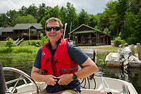 EB James Executive Director at Squam Lakes Assocation goes for a visit to SLA's two islands Moon and Bowman from Piper Cove on Thursday afternoon.  (Karen Bobotas/for the Laconia Daily Sun)