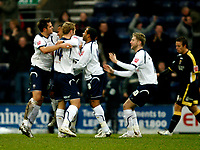 Photo: Paul Greenwood/Sportsbeat Images.<br />Preston North End v Cardiff City. Coca Cola Championship. 29/12/2007.<br />Preston's Simon Whalley (C) is congratulated by team mates after opening the scoring