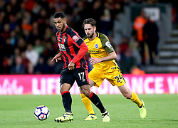AFC Bournemouth's Joshua King (left) and Brighton & Hove Albion's Davy Propper (right) battle for the ball