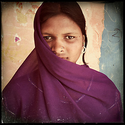 "iPhone portrait of Babli Maayida, approximate age 14, in a village outside of Banswara, Rajasthan, India, April 6, 2013. ""I did not like it when they said they want to get me married. I said, 'I'm very young right now and I don't want to get married. I want to study. . . . I'm a child,"" said Maayida.<br /> <br /> Under Indian law, children younger than 18 cannot marry. Yet in a number of India's states, at least half of all girls are married before they turn 18, according to statistics gathered in 2012 by the United Nations Population Fund (UNFPA). However, young girls in the Indian state of Rajasthan—and even a few boys—are getting some help in combatting child marriage. In villages throughout Tonk, Jaipur and Banswara districts, the Center for Unfolding Learning Potential, or CULP, uses its Pehchan Project to reach out to girls, generally between the ages of 9 and 14, who either left school early or never went at all. The education and confidence-building CULP offers have empowered young people to refuse forced marriages in favor of continuing their studies, and the nongovernmental organization has provided them with resources and advocates in their fight."