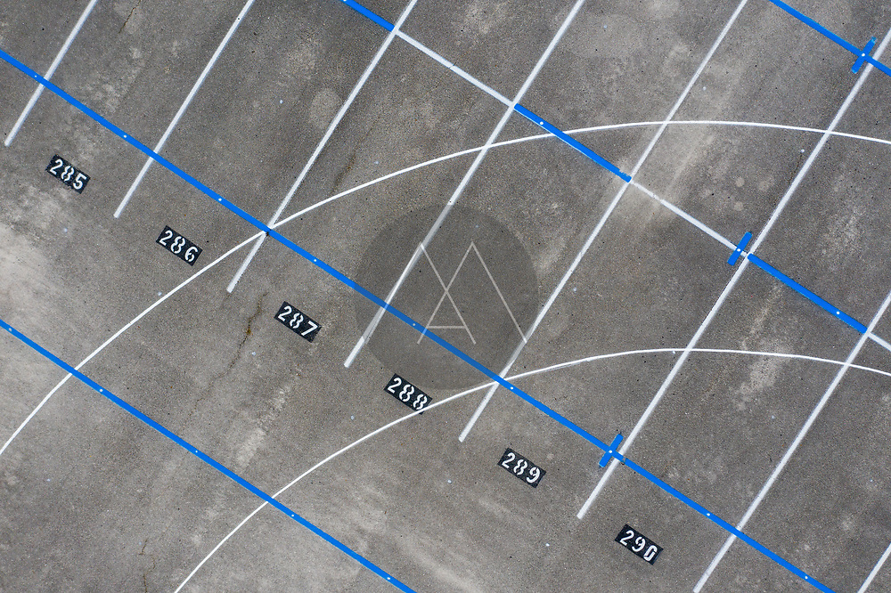 Aerial view of an empty parking lot with numbers on concrete at Sebastian River High School, Florida, United States.