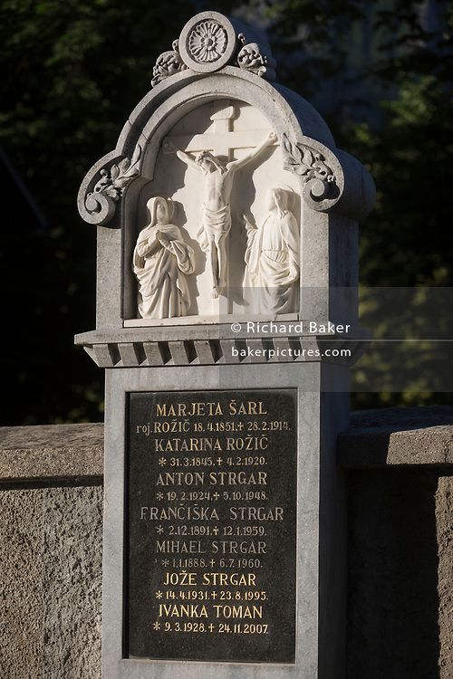 A family headstone going back a hundred years in a rural Slovenian village church, on 18th June 2018, in Bohinjska Bela, Bled, Slovenia.