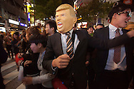 October 29, 2016, Tokyo, Japan: This is a team of humorous Japanese men acting as US Secret Service agents protecting presidential candidates Donald Trump, Hillary Clinton, president Barack Obama and Japanese Prime Minister Shinzo Abe. They were having their fun during the annual Halloween street festival in Tokyo's Shibuya district, the heart of Japanese youth culture. In the past few years, this informal Halloween street party has exploded in terms of size with tens of thousands of costumed party goers taking to the streets. Up until this boom, Halloween celebrations in the city (and across Japan) were minimal. This event has become so big that this year the Tokyo Metropolitan Police Department decided to close off two main streets adjacent to Shibuya Station. When Oct. 31 falls on a weekday, ninety percent of Halloween celebrations across Japan take place on the preceding Saturday. (Torin Boyd/Polaris).