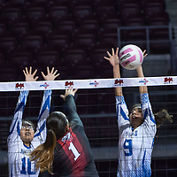 Laguna Acoma Hawks players Courtney Paytiamo (9) and Riley Antonio (10), work in tandem to block outside hitter Jessica Alanis's (1) attack at the net. Hatch Valley won 3-0 at the Santa Ana Star Center in Rio Rancho on Friday.