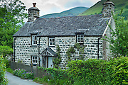 Traditional stone cottage with Welsh slate roof at Llanfihangel-Y-Pennant in Snowdonia, Wales