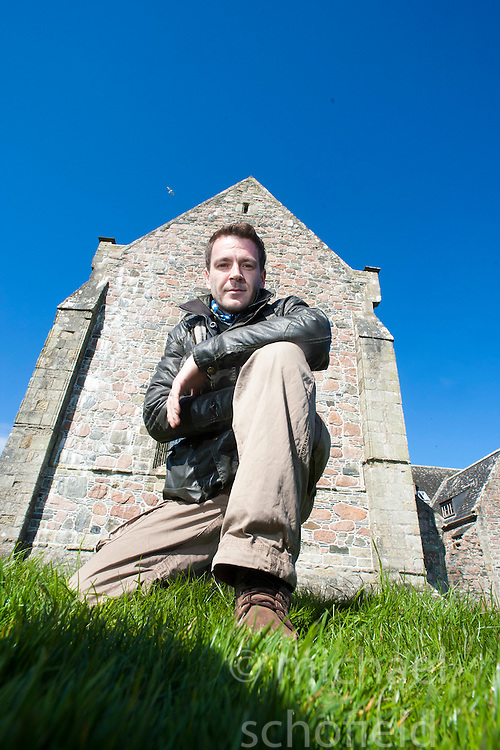 Historian Ashley Cowie at Iona Abbey, on Iona during his road trip. He is doing a seven part series for The Scottish Sun on Scotland's treasure hunts at the end of April..©Michael Schofield..