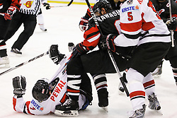 22.04.2010, Eishalle, IJssportcentrum, Tilburg, NED, IIHF Division I WM, Gruppe A, Österreich vs Japan im Bild Marco Pewal is attacked by Makoto Kawashima, EXPA Pictures © 2010, PhotoCredit: EXPA/ Fintan Planting