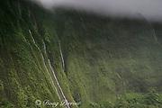 waterfalls drop down sheer cliffs from the highlands of Kauai, Hawaii, USA ( Central Pacific Ocean )