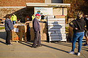 06 NOVEMBER 2020 - DES MOINES, IOWA: Volunteers wait for clients to arrive during an emergency food distribution at the Iowa State Fairgrounds Friday. A spokesperson for the Food Bank of Iowa said they had enough food for 1,500 families. Each family got frozen chicken legs, frozen liquid eggs, and fresh produce. There will be another emergency food distribution at the Fairgrounds on November 30. Food insecurity in the Des Moines area has skyrocketed since the start of the Coronavirus pandemic. Although unemployment rates in Iowa have fallen since a peak in June, many families that fell behind on rent are now facing eviction. The food bank spokesperson said use of the Food Bank's emergency pantries and distribution points is still increasing.    PHOTO BY JACK KURTZ