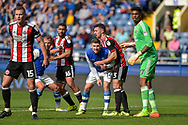 Sheffield Wednesday forward Gary Hooper (14) marked at a corner by Sheffield United defender Enda Stevens (3) during the EFL Sky Bet Championship match between Sheffield Wednesday and Sheffield Utd at Hillsborough, Sheffield, England on 24 September 2017. Photo by Adam Rivers.