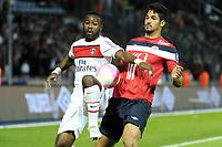 FOOTBALL - FRENCH CHAMPIONSHIP 2011/2012 - L1 - LILLE OSC v PARIS SAINT GERMAIN  - 29/04/2012 - PHOTO JEAN MARIE HERVIO / REGAMEDIA / DPPI - SIAKA TIENE (PSG) / TULIO DE MELO (LOSC)