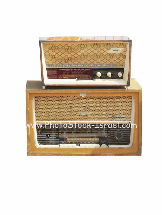 Cutout of two retro radio receivers on white background