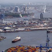 NLD/Rotterdam/20070423 - Rondvlucht boven de Rotterdamse haven in een helicopter, schip vaart een havenarm in