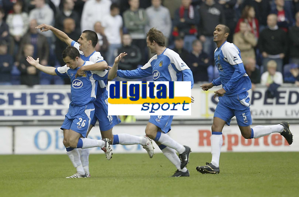 Photo: Aidan Ellis.<br /> Wigan Athletic v Manchester United. The Barclays Premiership. 14/10/2006.<br /> wigan's Paul Scharner jumps on goal scorer Leighton Baines back to celebrate the first goal