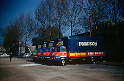 Line-up of trucks belonging to the Fordson tractor company during an agricultural exhibition in Paris in 1961. Looking pristinely clean with blackened wheels, the lorries have been driven over from the Ford Motor company factory at Dagenham near London, to this site in the French capital. On the side are the words Tracteuropa Demonstration Caravan. This is an annual expo of farming equipment such as tractors and this stand belongs to Ford, whose employees are over for this important exhibition in the industry calendar. The picture was recorded on Kodachrome (Kodak) film.