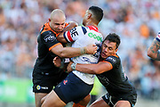 Daniel Tupou taken in a big Tigers tackle. Wests Tigers v Sydney Roosters. NRL Rugby League. ANZ Stadium, Sydney, Australia. 10th March 2018. Copyright Photo: David Neilson / www.photosport.nz