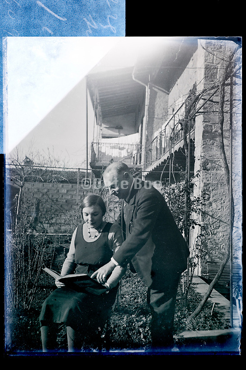 father and daughter posing with a book France 1934