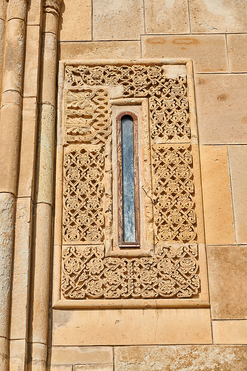 """picture & image of geometric stone work around a window of Samtavisi Georgian Orthodox Cathedral, 11th century, Shida Karti Region, Georgia (country)<br /> <br /> Built during the so called 10-11th century """"Georgian Golden Era"""" Samtavisi cathedral is a built in classical Georgian style of the period. Layout on a cruciform ground plan with a high central cylindrical central cupola. .<br /> <br /> Visit our MEDIEVAL PHOTO COLLECTIONS for more   photos  to download or buy as prints https://funkystock.photoshelter.com/gallery-collection/Medieval-Middle-Ages-Historic-Places-Arcaeological-Sites-Pictures-Images-of/C0000B5ZA54_WD0s<br /> <br /> Visit our REPUBLIC of GEORGIA HISTORIC PLACES PHOTO COLLECTIONS for more photos to browse, download or buy as wall art prints https://funkystock.photoshelter.com/gallery-collection/Pictures-Images-of-Georgia-Country-Historic-Landmark-Places-Museum-Antiquities/C0000c1oD9eVkh9c"""