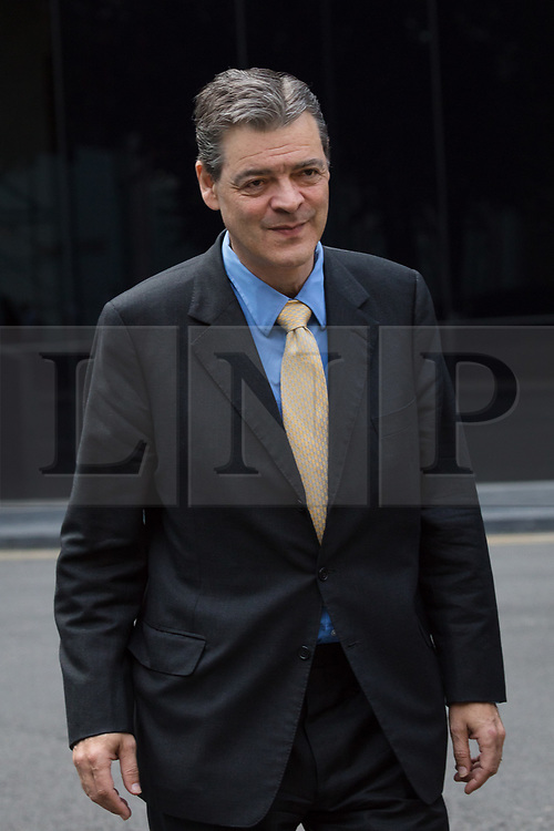 """© Licensed to London News Pictures. 25/08/2017. LONDON, UK.  London, UK. 25/08/2017. RHODRI PHILIPPS, the 4th Viscount St Davids arrives at Southwark Crown Court in London. Philipps was convicted after offering money on Facebook for someone to run over anti Brexit campaigner Gina Miller. He posted: """"£5,000 for the first person to 'accidentally' run over this bloody troublesome first generation immigrant"""" and described her as a """"boat jumper"""". Phillips is appealing against a conviction of two counts of sending menacing messages to Mrs Miller on a public electronic communications network. Photo credit: Vickie Flores/LNP"""