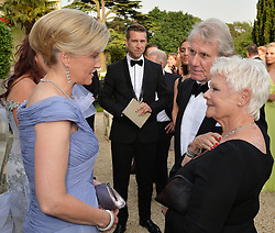 The Countessl of Wessex (left) talks with Dame Judi Dench and her partner David Mills, during a Gala Evening marking the 60th anniversary of The Duke of Edinburgh's Award, at Stoke Park, Stoke Poges, Buckinghamshire.