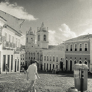 Man walking in front of the Jorge Amado Museum into the Pelourinho Neighbourhood in Salvador de Bahia, Brazil. It was the morning after the last day of Carnaval 2001. I chose to render this city in black and white - my film was loaded with Kodak High Speed Infrared film.