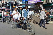Rickshaw with passengers at Khari Baoli in Old Delhi, India