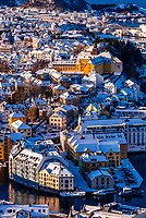 High angle panoramic view over the port city of Alesund, Norway and the surrounding archipelago. Much of the city is in Art nouveau style, the  town was rebuilt after a fire in 1904. Alesund is in the heart of Fjord Country, at the entrance to Geirangerfjord on Norway's west coast.